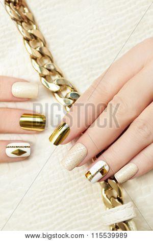 Gold manicure.