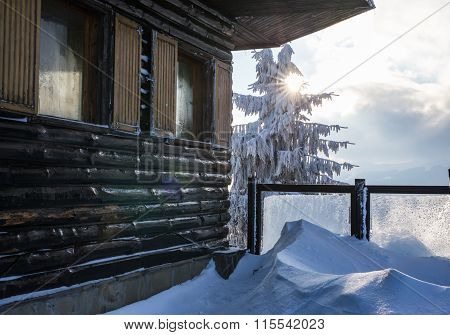 Wooden Chalet In The Winter Nature