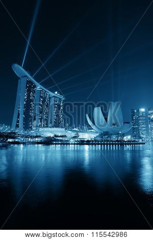 SINGAPORE - APR 5: Marina Bay Sands hotel light show at night on April 5, 2014 in Singapore. It is the world's most expensive building with cost of US$ 4.7 billion and landmark of Singapore.
