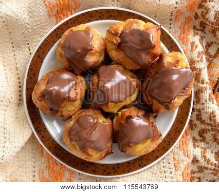 Tasty eclairs with cream in chocolate coating
