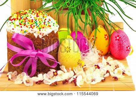 Fresh Easter Cake With Colorful Decorative Eggs And Spring Flowers And Grass
