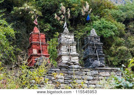 Three stone stupas.