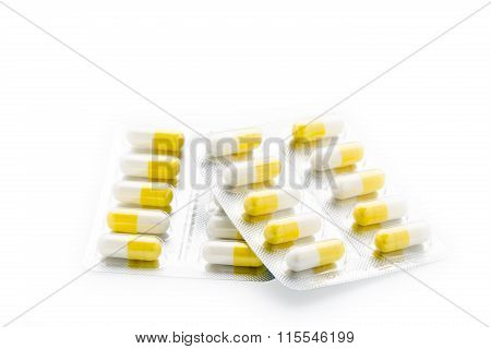 Yellow capsules pill blister pack