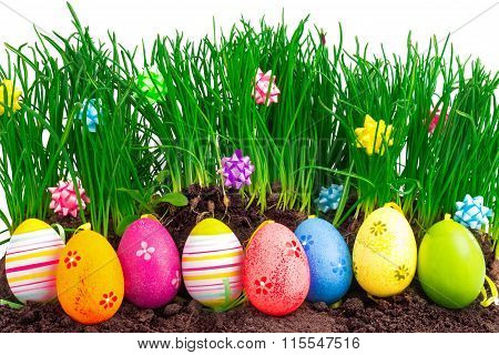 Colorful Easter Eggs With Spring Grass And Decoration