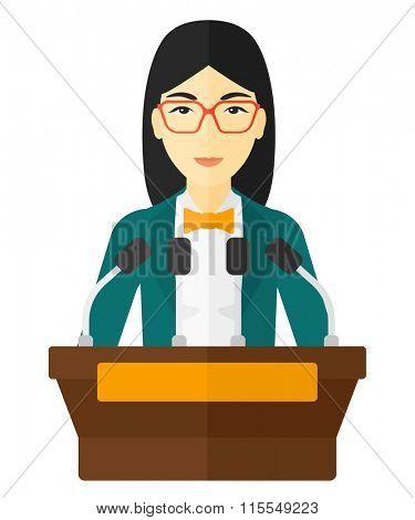 Woman speaking on podium.