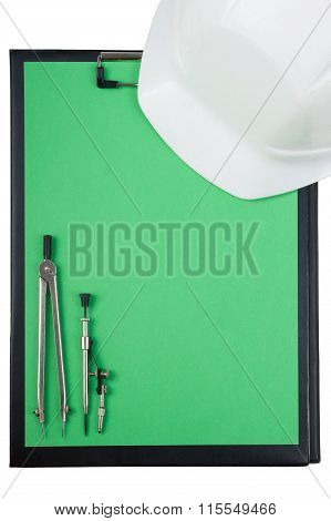 Engineering tools view from the top - Clipboard, divider compass, safety helmet