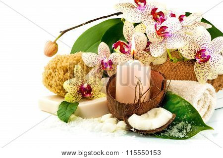 Spa Concept With Candle, Coconut, Orchid, Towels, Soap, Green Leaves