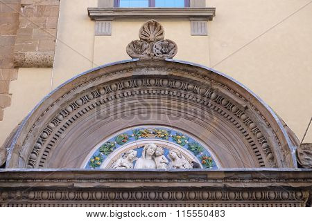 FLORENCE, ITALY - JUNE 05: Madonna with Child and Two Angels, lunette by Giovanni Buglioni, above the entrance of the Badia Fiorentina in Florence, Tuscany, Italy, on June 05, 2015