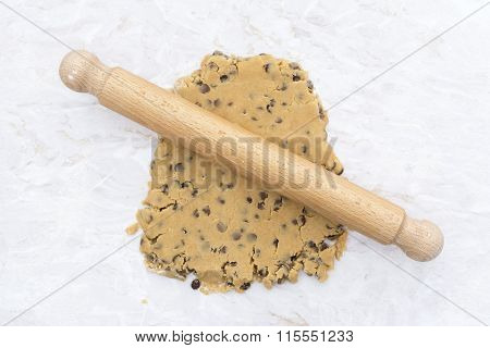 Cookie Dough Being Rolled Out With A Wooden Rolling Pin