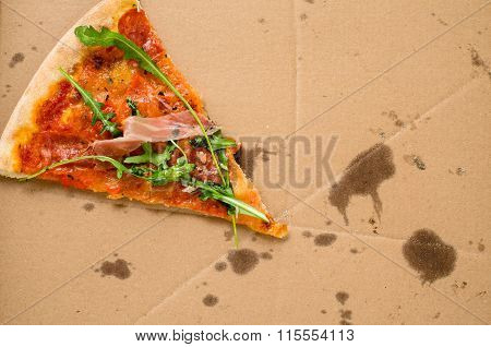 One piece of pizza in cardboard pizza box