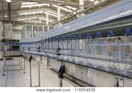 Plastic bottle production in the water bottling plant