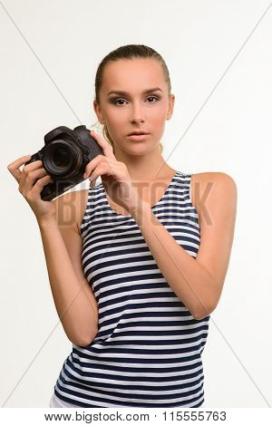 Girl photographer with camera.