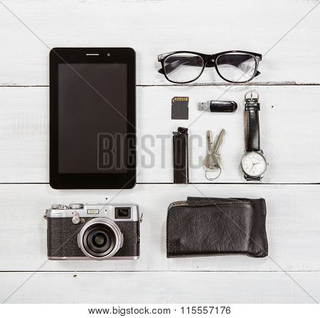 Travel  Concept - Set Of Camera, Tablet Pc And Other Travel Stuff On Wooden Table