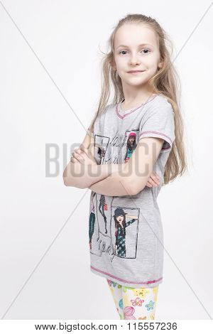 Portrait Of Nice And Cute Caucasian Blond Kid Posing Against White Background. Positive Facial Expre