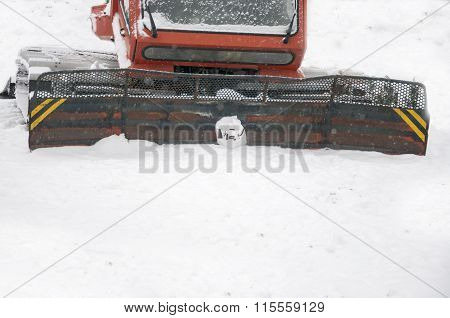 Snowplow on snow, close up with copy space