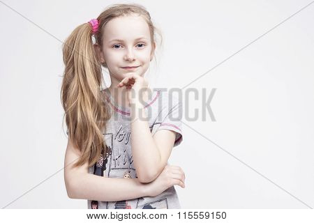 Portrait Of Cheerful Smiling Caucasian Female Blond Kid. Posing Against White Background