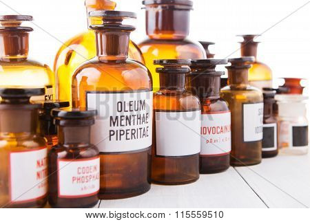 Bottle With Blank Label Among Various Vintage Pharmacy Bottles