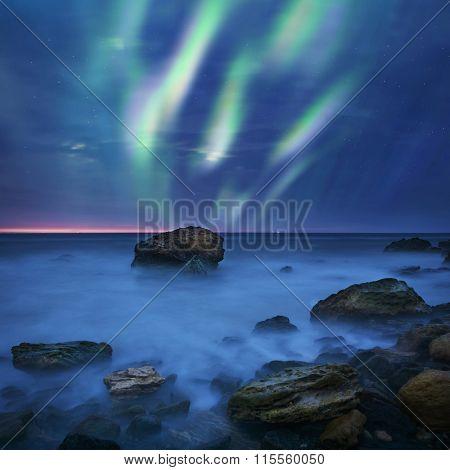 Green Aurora Borealis Over The Sea