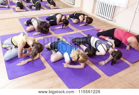 Sport, Fitness, Healthy Lifestyle Concepts. Group Of Caucasian Women Having Stretching Workout Indoo