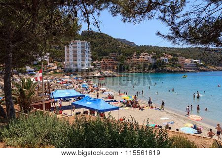 Bath bay Sant Elm full of bathers in Majorca Spain
