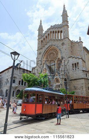 Tramcar and church in Soller, Majorca, Spain