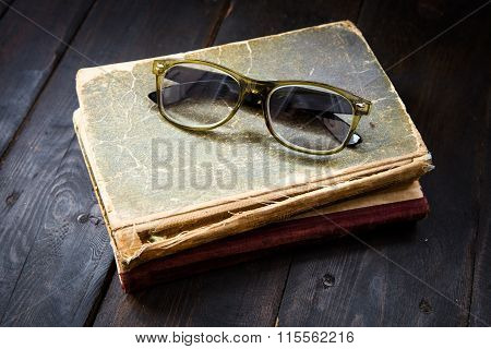 Vintage Reading Glasses On The Books Stack