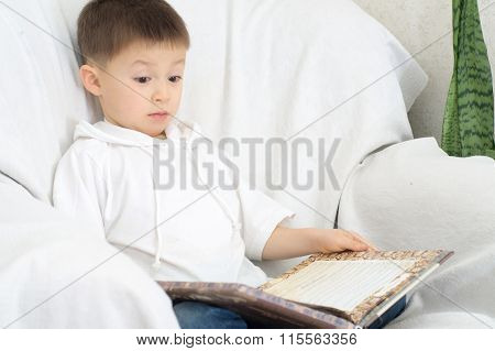 Boy Reading Book And Amazing