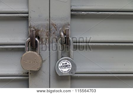 Two Padlocks On The Closed Iron Shutters