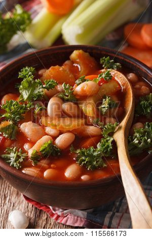 Bean Soup With Tomatoes And Celery Close-up. Vertical