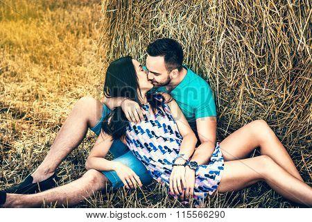 Happy Couple Kissing Near Hay Stock Outdoor