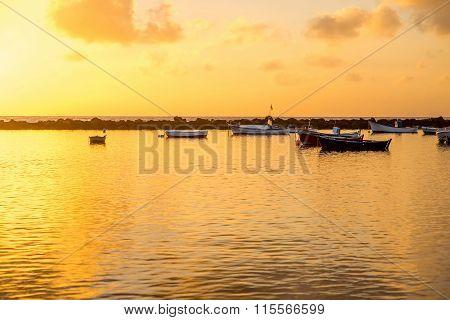 Fishing boats on the sunrise