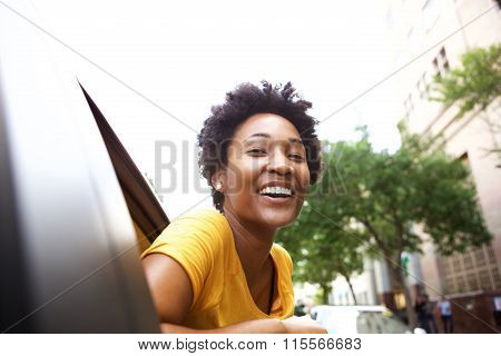 Smiling Young African Woman Looking Out The Car Window