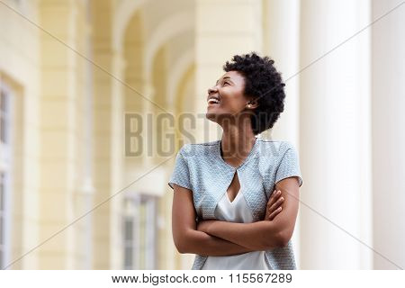 Smiling Young African Woman Standing Outdoors