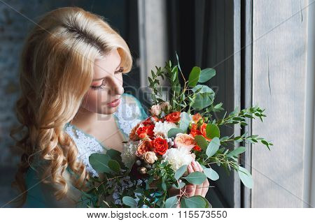 Charming Young Blond Woman Holding Fresh Flowers