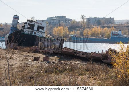 Partially Dismantled Boat On The River