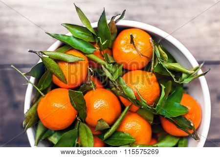 Fresh Picked Tangerine Clementines In White Bowl With Copy Space, Top View Image
