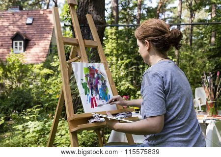 Woman Painting With Palette Knife