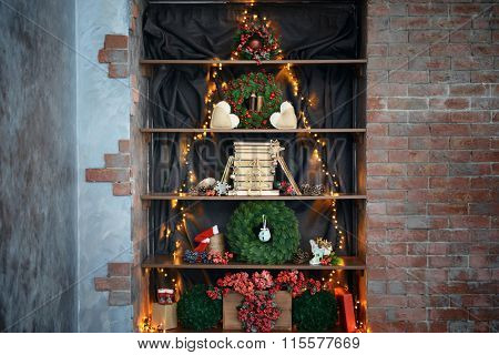 Christmas tree made of garland and other decor in bookcase