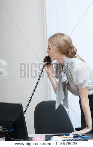 Busy Office Girl  On Landline Phone Call, Listening To Conversation