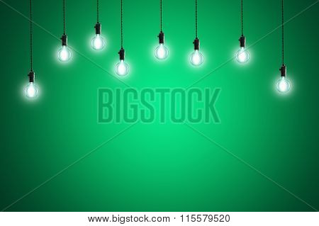 Idea Concept - Vintage Incandescent Bulbs On Green Background