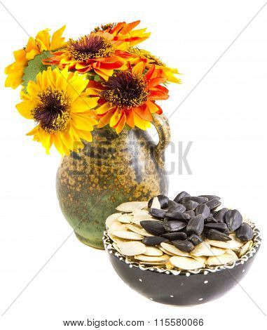Flowers and seeds of sunflower on a white background