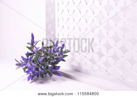 Purple flowers on a white openwork background