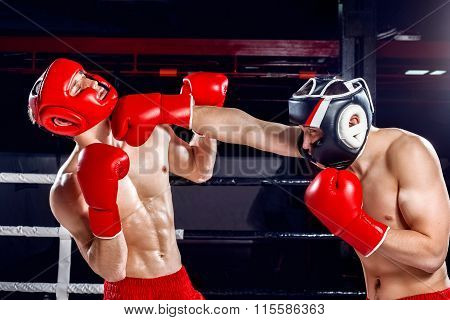 Experienced two boxers are fighting with each other