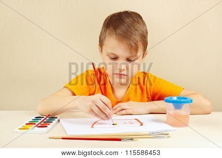 Beginner artist in orange shirt painting colors