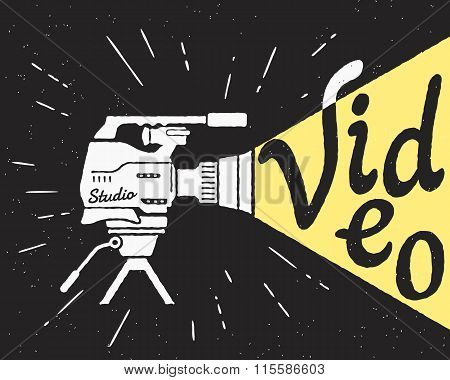 Professional video camera with yellow light letters