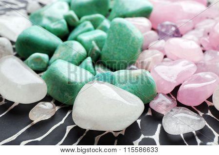 Beautiful mineral stones on dark surface