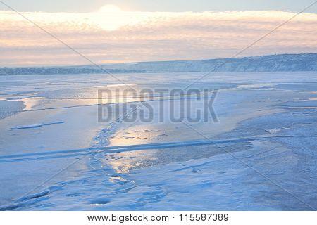 big sun over frosty landscape