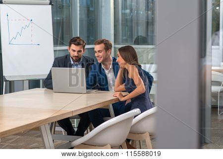Cheerful working team is discussing new project