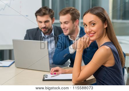 Cheerful young working team on business meeting