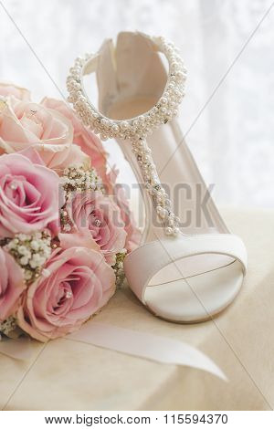 Bouquet With Pink Roses and Bride's shoe